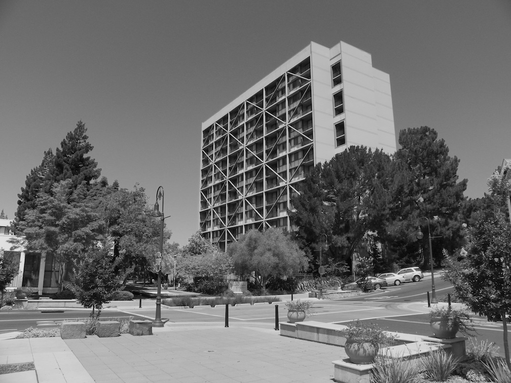 "The intersection of Virginia and Sacramento Streets, or the vicinity identified in Pearson's account of the shooting of black sailors—an anonymous and unrecognized ""anti-memorial"" to the 1942 uprising. The city of Vallejo truncated Virginia as part of 1960s urban redevelopment, creating this ""paseo,"" or pedestrian plaza. The Marina Tower looms large over the site (Photo by author, 2015)."